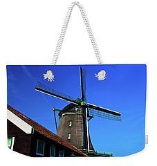 Weekender Tote Bag featuring the photograph De Zoeker Blue Skies by Jonah  Anderson