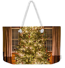Weekender Tote Bag featuring the photograph Decorated Christmas Tree by Alex Grichenko