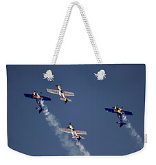 Weekender Tote Bag featuring the photograph Defying Law Of Gravity by Ramabhadran Thirupattur