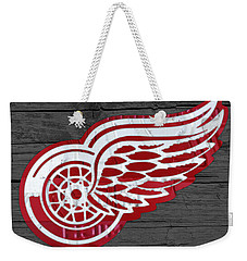 Detroit Red Wings Recycled Vintage Michigan License Plate Fan Art On Distressed Wood Weekender Tote Bag by Design Turnpike