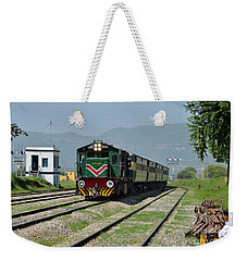 Weekender Tote Bag featuring the photograph Diesel Electric Locomotive Speeds Past Student by Imran Ahmed