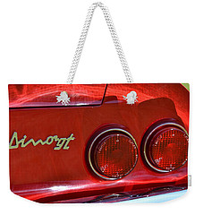 Weekender Tote Bag featuring the photograph Dino Gt by Dean Ferreira