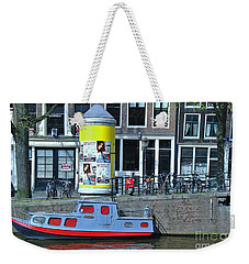 Weekender Tote Bag featuring the photograph Docked In Amsterdam by Allen Beatty