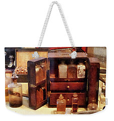 Weekender Tote Bag featuring the photograph Doctor - Case With Medicine Bottles by Susan Savad
