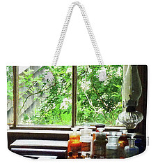 Weekender Tote Bag featuring the photograph Doctor - Medicine And Hurricane Lamp by Susan Savad