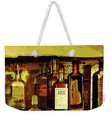 Weekender Tote Bag featuring the photograph Doctor - Syrup Of Ipecac by Susan Savad