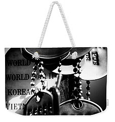 Weekender Tote Bag featuring the photograph Dog Tags From War by Steven Santamour