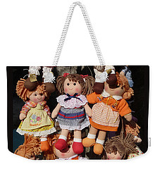 Weekender Tote Bag featuring the photograph Dolls by Marcia Socolik