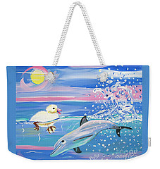 Dolphin Plays With Duckling Weekender Tote Bag by Phyllis Kaltenbach