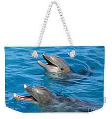 Weekender Tote Bag featuring the photograph Dolphins by Kristine Merc