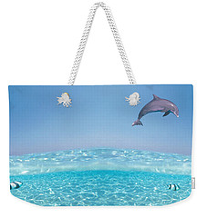 Dolphins Leaping In Air Weekender Tote Bag by Panoramic Images