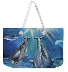 Weekender Tote Bag featuring the painting Dolphins Playing by Thomas J Herring