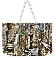 Weekender Tote Bag featuring the photograph Downtown In Jerusalems Old City by Doc Braham