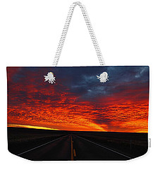 Weekender Tote Bag featuring the photograph Dramatic Sunrise by Lynn Hopwood