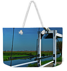 Weekender Tote Bag featuring the photograph Drawbridge At Zaanse Schans by Jonah  Anderson