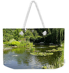 Weekender Tote Bag featuring the photograph Dreamy Pond by Verana Stark