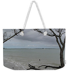Weekender Tote Bag featuring the photograph Driftwood On The Beach by Christiane Schulze Art And Photography