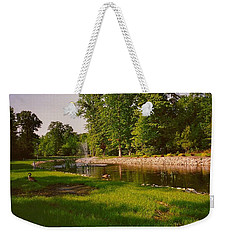Weekender Tote Bag featuring the photograph Duck Pond With Water Fountain by Amazing Photographs AKA Christian Wilson