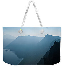 Weekender Tote Bag featuring the photograph Early Morning Fog Over Crater Lake by Jeff Goulden