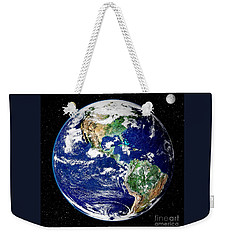 Weekender Tote Bag featuring the photograph Earth From Space by Pg Reproductions
