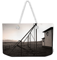 Weekender Tote Bag featuring the photograph Echoes Of Laughter by Jim Garrison