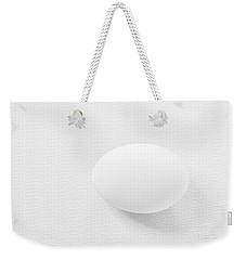 Weekender Tote Bag featuring the photograph Egg On White Tablecloth by Ludwig Keck