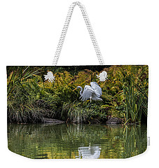 Weekender Tote Bag featuring the photograph Egret At The Lake by Chris Lord