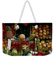 Weekender Tote Bag featuring the photograph Glowing Paris Fruit Display by Tom Wurl