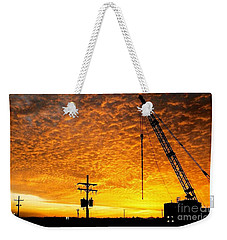 Erecting A Sunset In Beaumont Texas Weekender Tote Bag