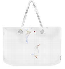 Weekender Tote Bag featuring the photograph Ethereal Gulls by Peggy Collins