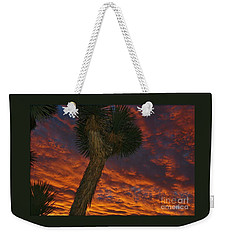 Weekender Tote Bag featuring the photograph Evening Red Event by Angela J Wright