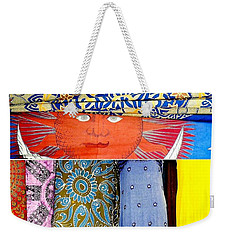 Weekender Tote Bag featuring the photograph New Orleans Eye See Fabric In Lifestyles by Michael Hoard