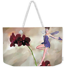 Weekender Tote Bag featuring the photograph Fairy In The Orchid Garden by Rosalie Scanlon