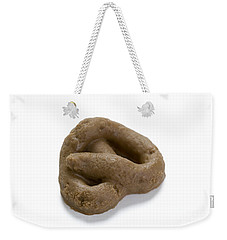 Weekender Tote Bag featuring the photograph Fake Dog Poop by Lee Avison