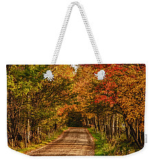 Fall Color Along A Dirt Backroad Weekender Tote Bag by Jeff Folger
