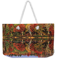 Weekender Tote Bag featuring the photograph Fall Color Reflected In Thornton Lake Michigan by Dave Welling