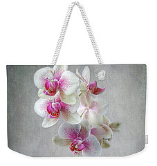 Weekender Tote Bag featuring the photograph Fancy Orchids by Louise Kumpf