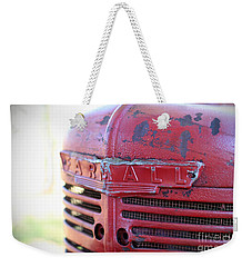 Weekender Tote Bag featuring the photograph Farmall by Todd Blanchard
