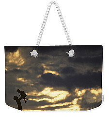 Father Holding Daughter Above His Head Along Hillside Silhouette Weekender Tote Bag