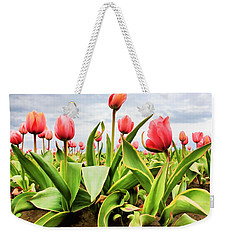 Weekender Tote Bag featuring the photograph Field Of Pink Tulips by Athena Mckinzie