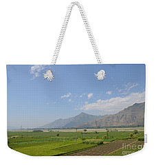 Weekender Tote Bag featuring the photograph Fields Mountains Sky And A River Swat Valley Pakistan by Imran Ahmed