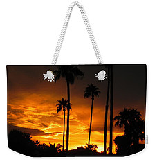Weekender Tote Bag featuring the photograph Fiery Sunset by Deb Halloran