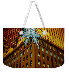 Weekender Tote Bag featuring the photograph Fifth Avenue Holiday Star by Chris Lord