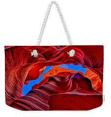 Weekender Tote Bag featuring the photograph Fire Beneath The Sky In Antelope Canyon by Greg Norrell