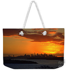 Weekender Tote Bag featuring the photograph Fire In The Sky by Miroslava Jurcik