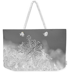 Weekender Tote Bag featuring the photograph First Snowflake by Rona Black