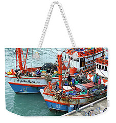 Weekender Tote Bag featuring the photograph Fisherman by Andrea Anderegg