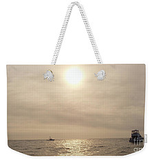 Weekender Tote Bag featuring the photograph Fishing Montauk by John Telfer