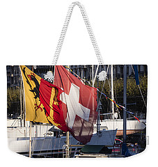 Weekender Tote Bag featuring the photograph Flags by Muhie Kanawati