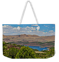 Weekender Tote Bag featuring the photograph Flaming Gorge by Janice Rae Pariza